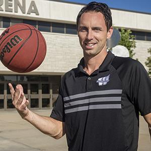 Brett Ballard in front of Lee Arena