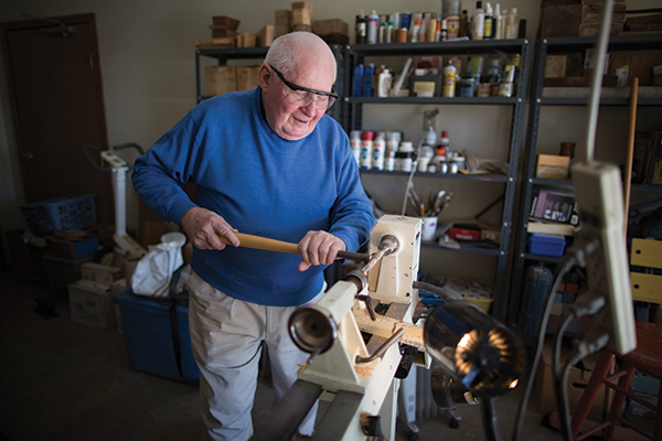 John Buckner turns wood in his garage