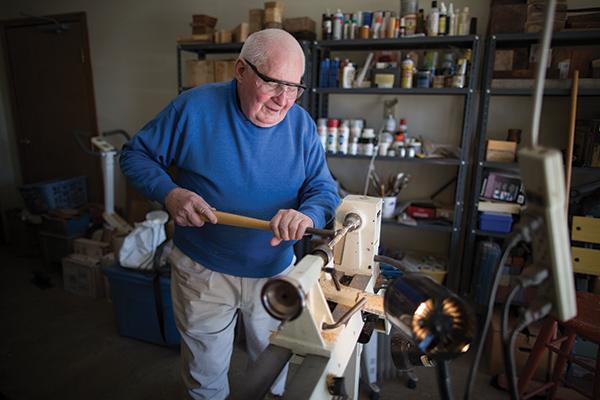 John Buckner turns wood in his garage