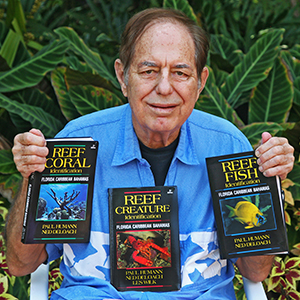 Paul Humann with books he's published