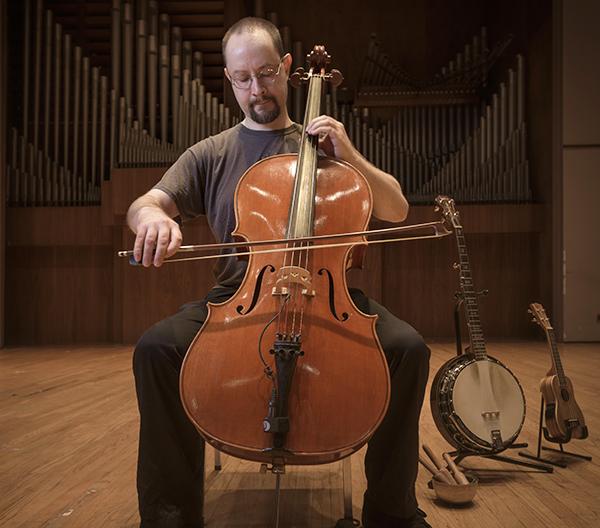 Aaron Martin playing cello
