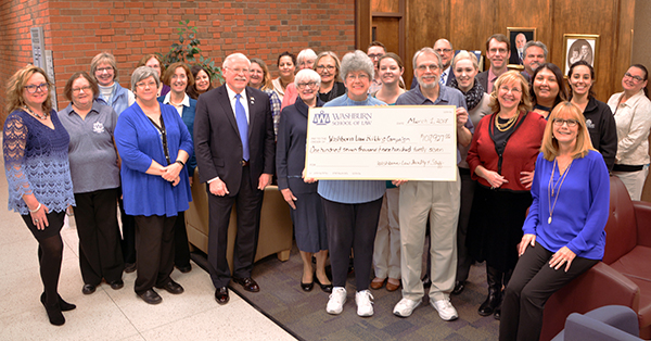 School of Law faculty and staff check presentation