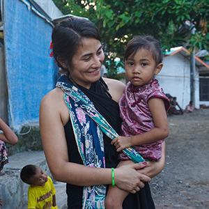 Mariana Yoshita holding a child