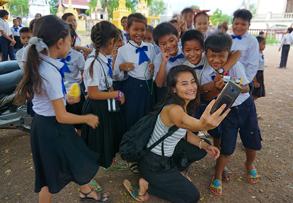 Mariana Yoshita with students in Cambodia