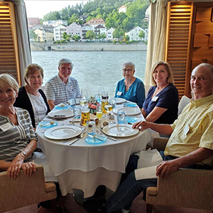 Alumni and friends dining on the Danube River cruise