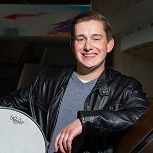 Daniel Alberson posing with drum