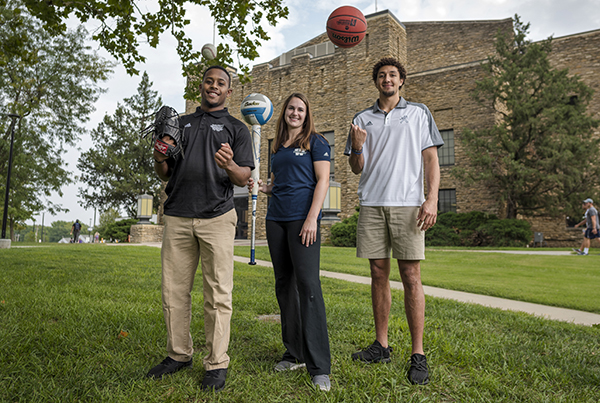 Darian Abram, Alyssa Carney and Brady Skeens pose