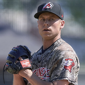 Brett Ash pitching for the Travelers