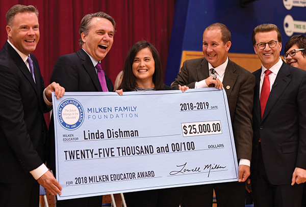 Linda Dishman receives her check