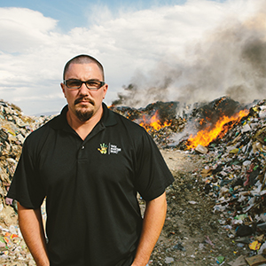 Brett Durbin in a trash mountain community