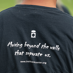 Inside Out t-shirt that says moving beyond the walls that separate us