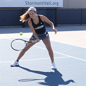 Madeline Lysaught playing tennis