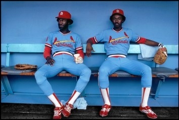 """The 1979 Walter Ioos photograph, """"Tony Scott and Garry Templeton, Dodger Stadium, Los Angeles, CA,"""" shows two baseball players relaxed in their dugout."""