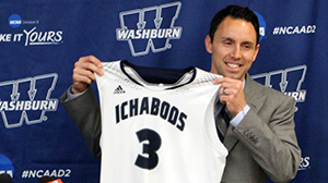 Brett Ballard holds up a Washburn jersey during his press conference