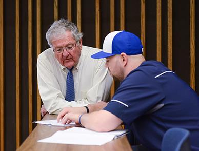 Gary Baker help student